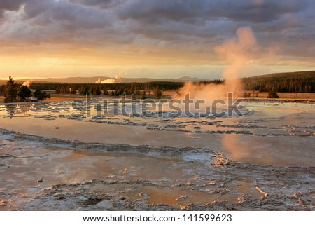 Steam rising from the Firehole Geyser, Yellowstone National Park, Wyoming, USA. - stock photo