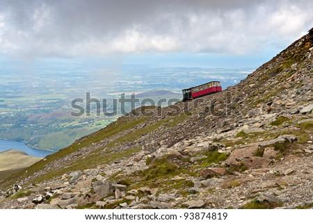 Steam Train heading to the Snowdon summit, Snowdonia, Wales - stock photo