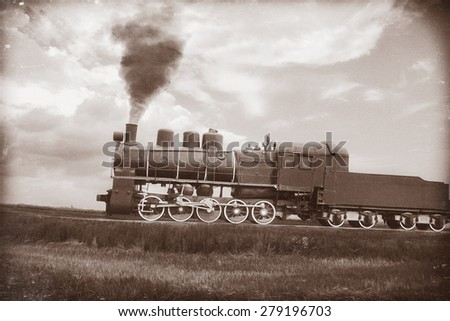 Steam train in vintage sepia. Textured with old paper and retro scratches. - stock photo