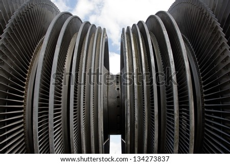 Steam turbine of nuclear power plant against the sky - stock photo