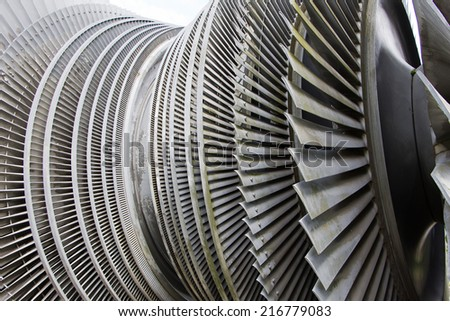 Steam turbine of nuclear power plant in sunlight - stock photo