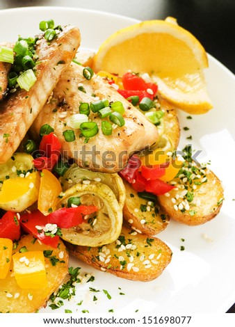 Steamed and baked sturgeon with stir-fry vegetables. Shallow dof.  - stock photo