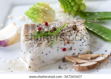 Steamed Atlantic Cod fish with spices and vegetable - stock photo