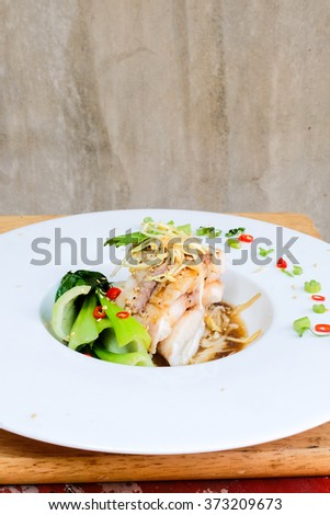 Steamed Atlantic Cod fish with spices and vegetable in Chinese style.Healthy food.Clean food . - stock photo