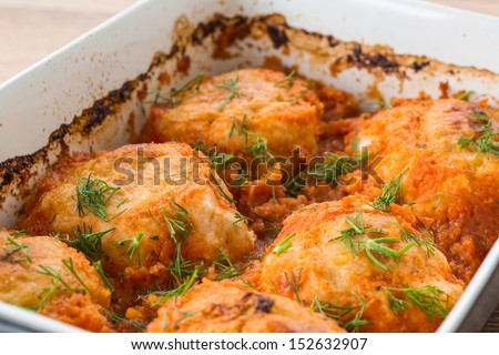 steamed chicken meatballs in tomato sauce with dill - stock photo
