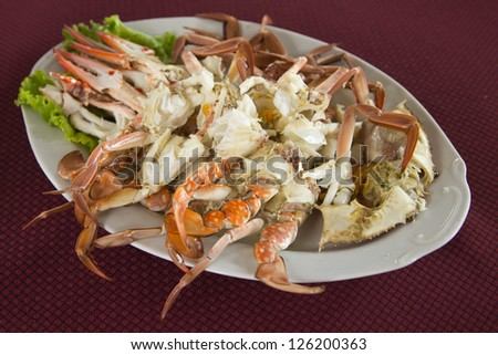Steamed Crab Legs with Thai spicy seafood sauce - stock photo