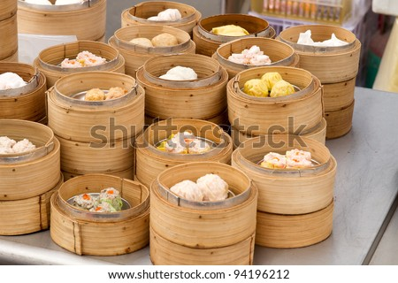 Steamed Dim Sum in Bamboo Trays by Local Street Food Vendors in Melaka Malaysia - stock photo