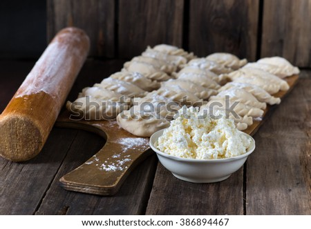 Steamed dumplings filled with  cottage cheese (vareniki). - stock photo