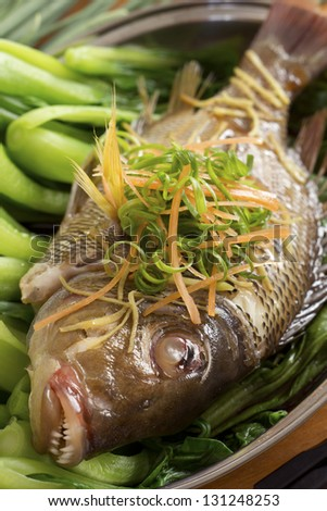 Steamed Fish on Bed of Bok Choi; Non sharpened file - stock photo