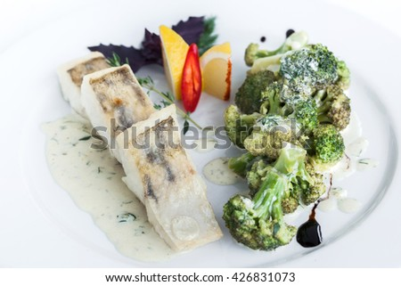 Steamed fish with broccoli - stock photo