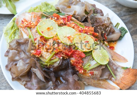 Steamed fish with spicy sauce, Thai style food - stock photo