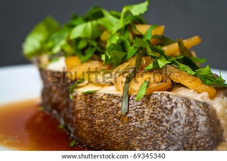 Steamed halibut in soy sauce - stock photo