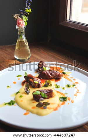 Steamed in white wine beef with potato cream and thick gravy - stock photo