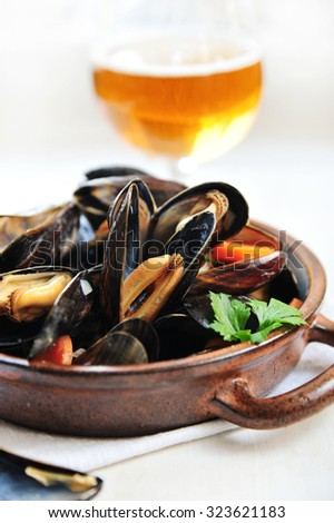 Steamed mussels in beer - stock photo