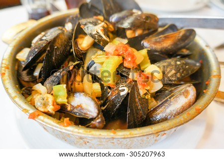 Steamed mussels in white wine sauce  - stock photo