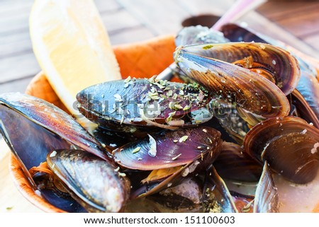 Steamed mussels with lemon slice. - stock photo