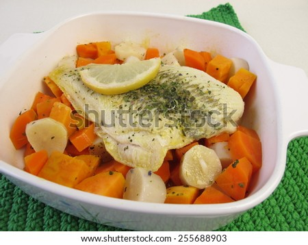 Steamed plaice on vegetables in cooking pot - stock photo