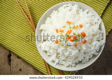 Steamed rice close-up with chopsticks on a fabric mat - stock photo