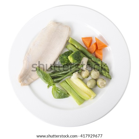 Steamed trout fillet with vegetables. Isolated on a white background. - stock photo