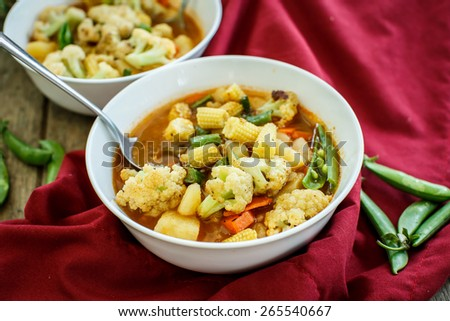 Steamed vegetables in a bowl on wooden table - stock photo