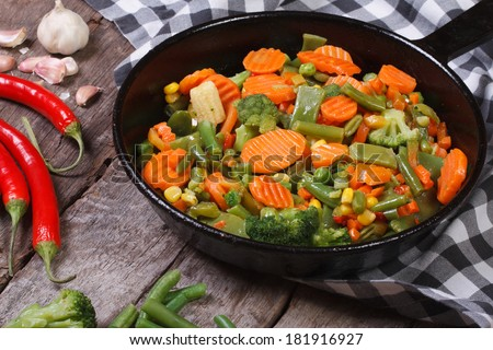steamed vegetables in a pan on the table. horizontal. close-up  - stock photo
