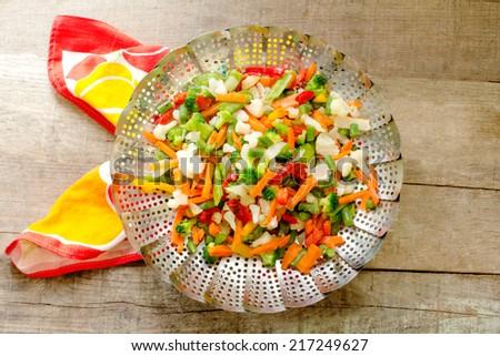 steamed vegetables inside steam basket - stock photo