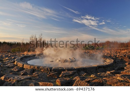 Steaming geothermal hot water in fountain, Reykjavik, Iceland - stock photo