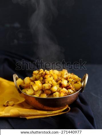 Steaming kadai of Dry Potato Curry - stock photo