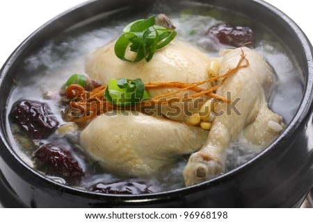 steaming samgyetang, chicken soup with ginseng, korean food - stock photo