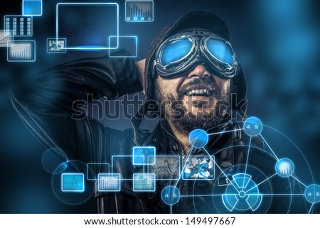Steampunk concept, happy pilot vintage with big glasses, posing, electronic console - stock photo