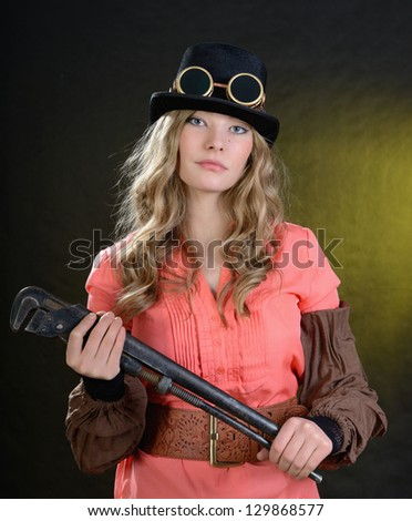 Steampunk female with adjustable wrench. - stock photo