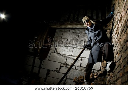 steampunker in industrial scary place is attacking - stock photo