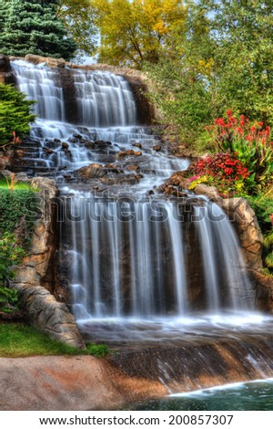 Steams of misty water fall down the hill in High Dynamic Range - stock photo