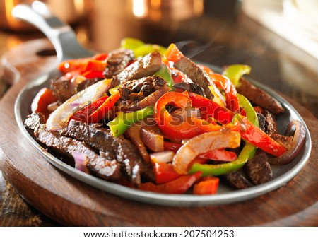 steamy hot mexican beef fajitas - stock photo