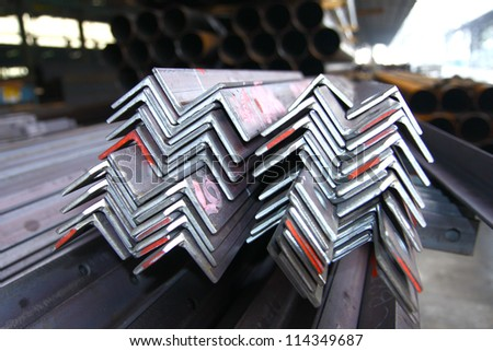 Steel angles bunch in warehouse. - stock photo