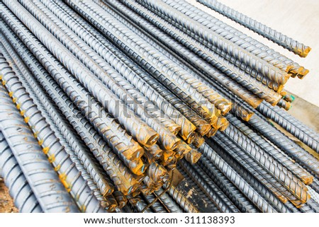 Steel bars close-up background. Reinforcing bar background. - stock photo