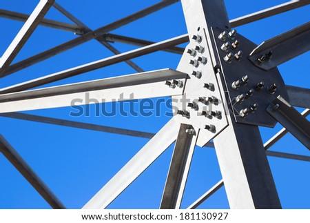 Steel beams against the blue sky. Metal framework. - stock photo