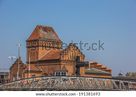 Steel bridge and old building in Lubeck, Germany - stock photo