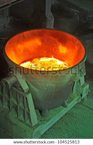 steel bucket to transport the molten metal - stock photo
