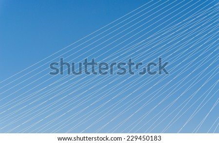 Steel cables over sky background. - stock photo