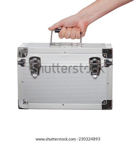 Steel case in a human hand isolated on white background - stock photo