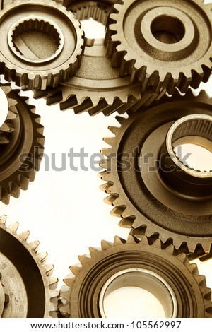 Steel cogs meshing together - stock photo