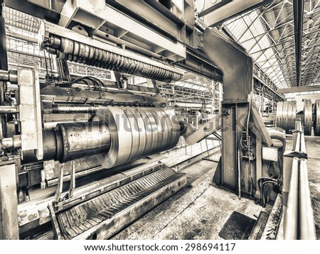 Steel coil cut machine. Industrial environment. - stock photo