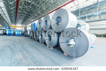 Steel coils inside a factory. - stock photo