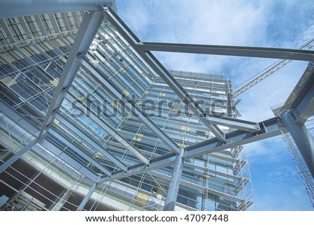 Steel construction on modern facility building with a blue sky - stock photo