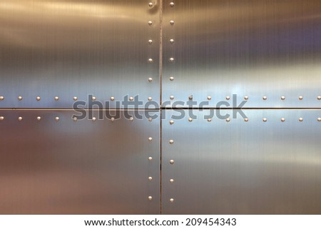 steel design background with nut - stock photo