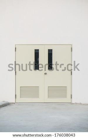 Steel door at factory building, Thailand - stock photo