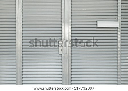Steel door closed with white mail box - stock photo