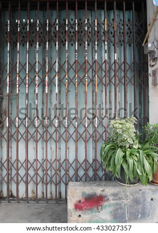 Steel door stretch.An old style of close steel door, lock on iron door, - stock photo