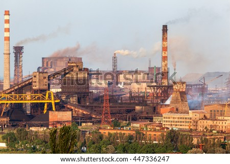 Steel factory with smokestacks at sunset. metallurgical plant. steelworks, iron works. Heavy industry in Europe. Air pollution from smokestacks, ecology problems. Industrial landscape - stock photo